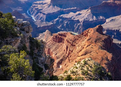 View to Colorado river at Grand Canyon with multi  colored mountain terrain. Arizona, USA