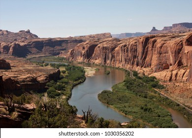 View of the Colorado River from Moab Rim trail.  Empty space for text, quote, or saying on sky background.