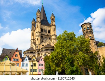 View of colorful architecture and old church in Cologne Germany