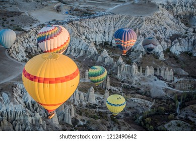 View of colorful hot air balloons flying over Love Valley during the sunrise in the morning, Cappadocia, Turkey