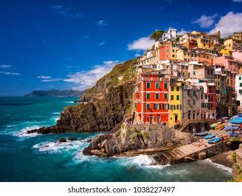 View of the colorful houses along the coastline of Cinque Terre area in Riomaggiore