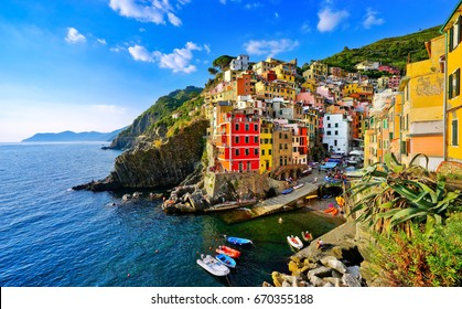 View of the colorful houses along the coastline of Cinque Terre area in Riomaggiore, Italy.