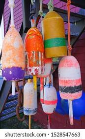 View of colorful lobster trap market buoys in Lunenburg, Nova Scotia, Canada
