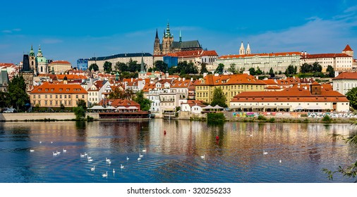 View of colorful old town and Prague castle with river Vltava, Czech Republic