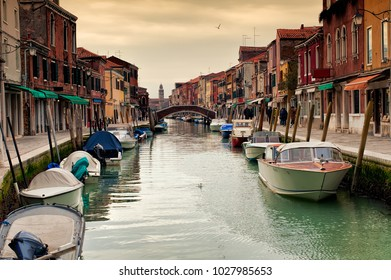 View of the colorful Venetian houses along the canal at the Islands of Murano in Venice, Italy.