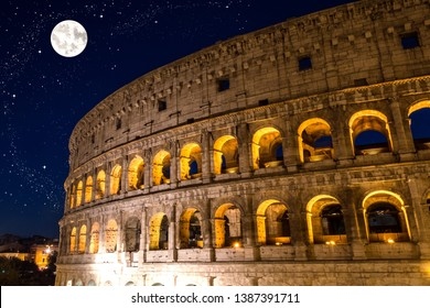 View of the Coloseum by night with big full moon and stars in the sky, Rome