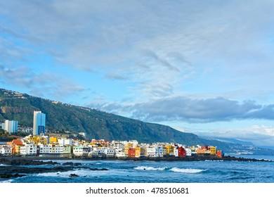 View of colourful houses of Punta Brava from beach Jardin in Puerto de la Cruz, Tenerife, Canary Islands, Spain