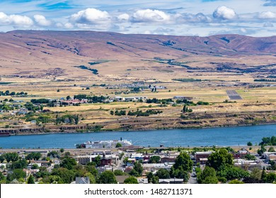 A view of the Columbia River, a stern wheeler river boat, and the city of the Dalles, Oregon