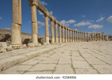 View of column in the Oval Plaza at the ancient Roman city of Jerash, Jordan. Note the columns that are offset on the left side of the photo.