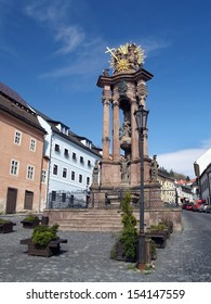 View of Column of the Virgin Mary and the Holy Trinity located on Holy Trinity Square in Banska Stiavnica town, Slovakia. Banska Stiavnica is historic medieval town inscribed in UNESCO heritage list.