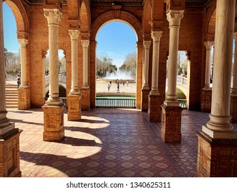 View of columns, architecture buildings and fountain on the Plaza de Espana on February 2019 in Seville, Spain.
