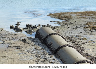 View of concrete stormwater pipe discharge into ocean