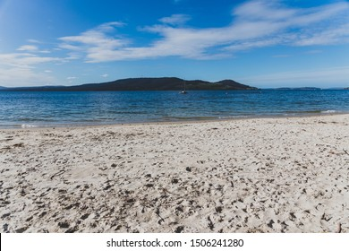 view of Conningham Beach in Tasmania, Australia with sunshine and no people, with its pristine rugged coastal beauty