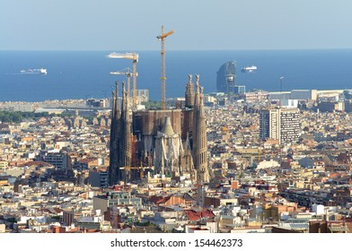 View of the construction Sagrada Familia and over the sea of houses in Barcelona. With approx. 1.6 million inhabitants, Barcelona is the capital from Catalonia