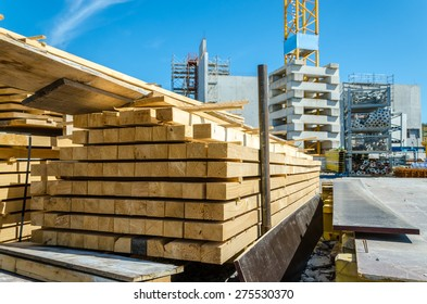 View of construction site with stack of timber