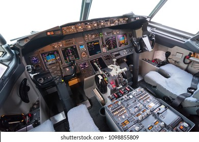 View of contpol panel of plane. Flight desk in cockpit of a commercial airplane with isolated windows