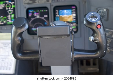 View of control wheel and modern glass instrument panel from the pilot's seat