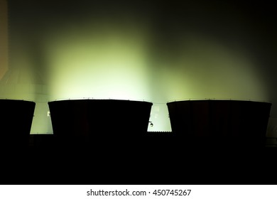 view of cooling towers coal power plant  at night