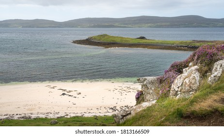 View of Coral Beach and surrounding nature at low tide on the Isle of Skye, Scotland. Beautiful white beach is a popular place for tourists