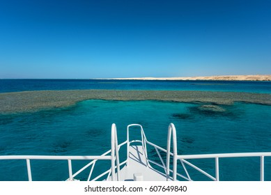 View at the coral sea from white yacht. Perfect place for snorkeling. Summer vacation
