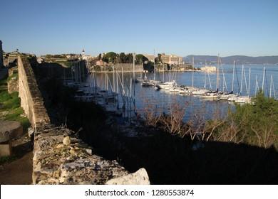 View of  Corfu (Kerkyra). Kerkyra - capital of Corfu island, Greece. Panagia Vlacherna and the island of Pontikonissi (mouse island) near Kanoni, Corfu.