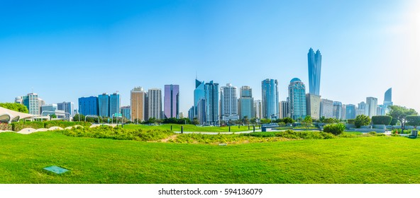 View of a corniche in Abu Dhabi stretching alongside the business center full of high skyscrapers.