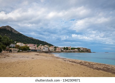 View of the Corsican village Algajola from the sandy beach, France
