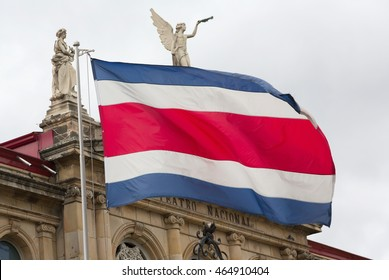 View of the Costa Rica flag in the background of the National Theater (focus on flag)