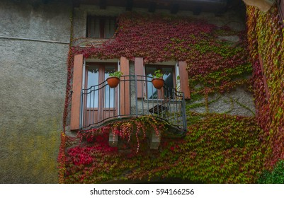 View of cosy balcony in a small town at lake Como Italy.