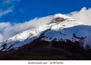 View of the Cotopaxi volcano on a sunny afternoon with a little cloud