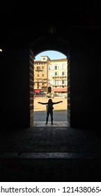 A view of courtyard, gate and tower of Piazza del Campo