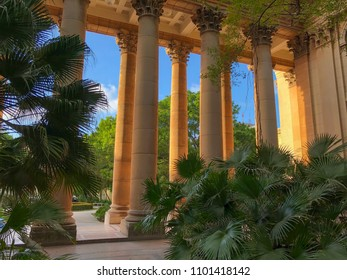 view from the courtyard of the University on the colonnade in sunny evening with a lot of different plants