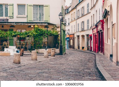 View of cozy street in quarter Montmartre in Paris, France. Architecture and landmarks of Paris. Postcard of Paris