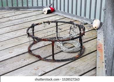 View of a crab trap on a deck with buoys