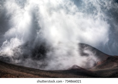 View of a crater on mount Etna in Sicily, Italy on a cloudy Autumn day