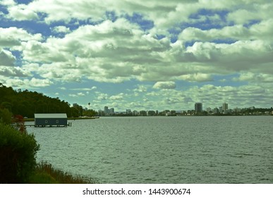 View of Crawley Edge Boatshed, Blue Boat House with blue sky and white cloud in Perth, Australia