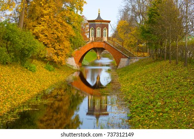View of the Cross Bridge in the golden autumn. Alexandrovsky Park of Tsarskoye Selo, St. Petersburg