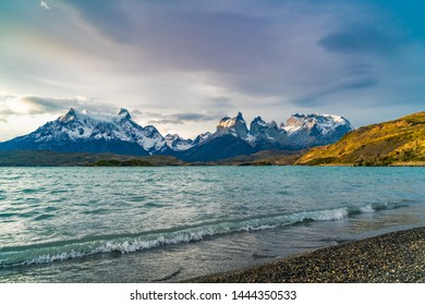 View of Cuernos del Paine mountains and Pehoe Lake in the evening at Torres del Paine National Park, Chile