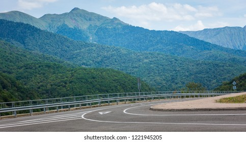 A view of a curved road. Driving a car on mountain road. Asphalt road in mountain. Empty road background