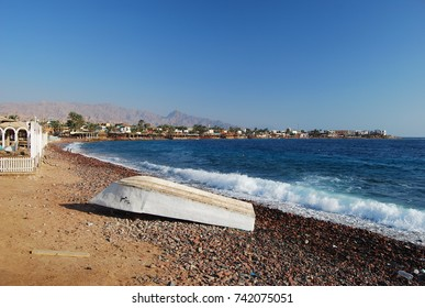 View of Dahab village coast  with boat in Egypt. Sinai peninsula