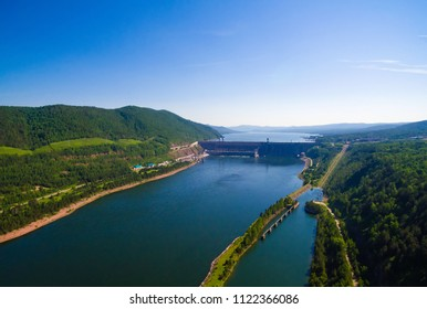 View of a dam of hydroelectric power station, reservoir, on the Yenisei River, shooting from air