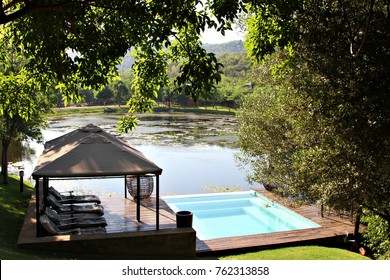 View of a dam or lake over a beautiful deck and pool area at a game lodge in rural South Africa.