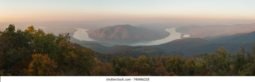 view of Danube curve from Pilis mountain in october autumn landscape, misty sunset