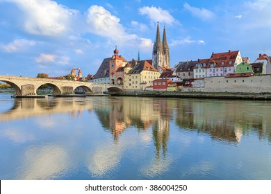 View from Danube on Regensburg Cathedral and Stone Bridge in Regensburg, Germany