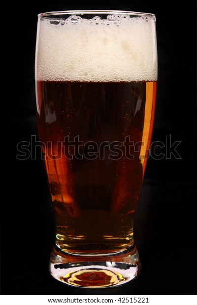 A view of dark beer isolated on black