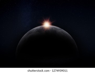 View of the dark hidden side of the Moon with the Sun behind it. Negative space for copy text. Elements of this image furnished by NASA