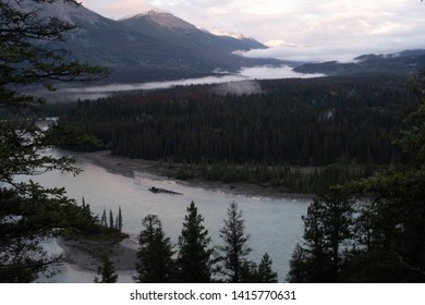 A view at daybreak of the Athabasca River as it weaves its way through the Jasper National Park, Canada, on a cloudy day