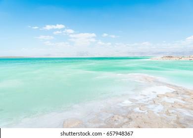 View of Dead Sea coastline. Salt crystals. Texture of Dead sea. Salty sea shore