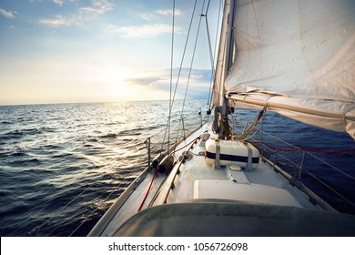 View from the deck to the bow of a sail yacht tilted in a wind o