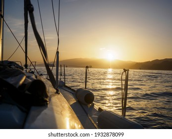the view from the deck to the bow of the sailboat in the background of the setting sun, adventure, sailing, tenerife